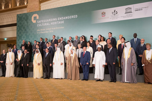 ABU DHABI, UNITED ARAB EMIRATES - December 03, 2016: (front row L-R) HH Prince Aga Khan IV, HH Sheikh Jassim bin Hamad Al Thani Personal Representative of the Emir Qatar, HRH Prince Khalid al Faisal Advisor to the Custodian of the Two Holy Mosques and Governor of Makkah Region, HE Ashraf Ghani President of the Islamic Republic of Afghanistan, HH Sheikh Mohamed bin Rashid Al Maktoum, Vice-President, Prime Minister of the UAE, Ruler of Dubai and Minister of Defence, HE Francois Hollande, President of France, HH Sheikh Mohamed bin Zayed Al Nahyan, Crown Prince of Abu Dhabi and Deputy Supreme Commander of the UAE Armed Forces, HH Sheikh Sabah Al Ahmad Al Jaber Al Sabah Emir of Kuwait, HE Abdrabbuh Mansour, Hadi President of Yemen, HE Ibrahim Boubacar Keita, President of Mali, HE Hailemariam Desalegn Prime Minister of Ethiopia, HH Sheikh Nasser bin Hamad bin Isa Al Khalifa, HE Yusuf bin Alawi bin Abdullah Foreign Minister of Oman (R), (2nd row) HE Alexis Tsipras, Prime Minister of Greece (3rd L), HE Denis Zvizdic, Chairman of the Council of Ministers of Bosnia and Herzegovina (4th L), HE Jack Lang President of Institut  du Monde Arabe (5th L), HE Mohamed Khalifa Al Mubarak Chairman of Abu Dhabi Tourism & Culture Authority (6th L), HE Irina Bokova Director General of UNESCO (7th L) and other dignitaries, stand for a photograph during the Safeguarding Endangered Cultural Heritage Conference at Emirates Palace. (PRNewsFoto/Abu Dhabi Tourism & Culture Aut)