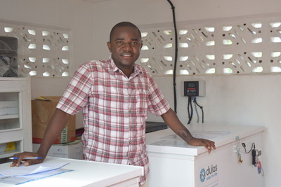 In Ebola-affected Sierra Leone, Pharmacist Paul Borboh stands next to the clinic's new vaccine storage fridges that contain the first doses of Janssen's prime-boost vaccine regimen.