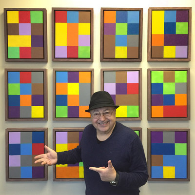 """Artist Cano Ozgener in front of his Pi Synesthesia work called """"Pi by the Dozen"""""""