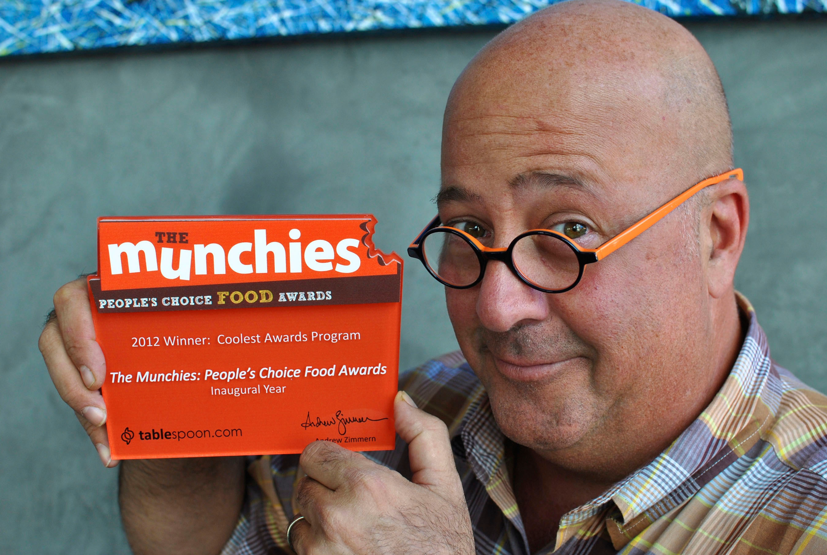 Andrew Zimmern heads up panel of food personalities to select nominees for second annual Munchies Awards: The People's Choice Food Awards. The people will select the best form 20 categories from best food truck to best food city, best taco to best coffee shop and best chef to best TV food show . Voting begins today through April 30th at Tablespoon.com/themunchies.  (PRNewsFoto/General Mills)