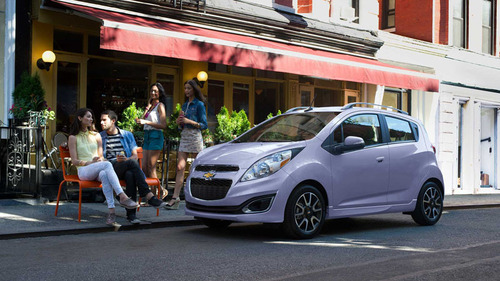 The attractive colors of the 2014 Chevy Spark helps owners express themselves while catching the eyes of other ...