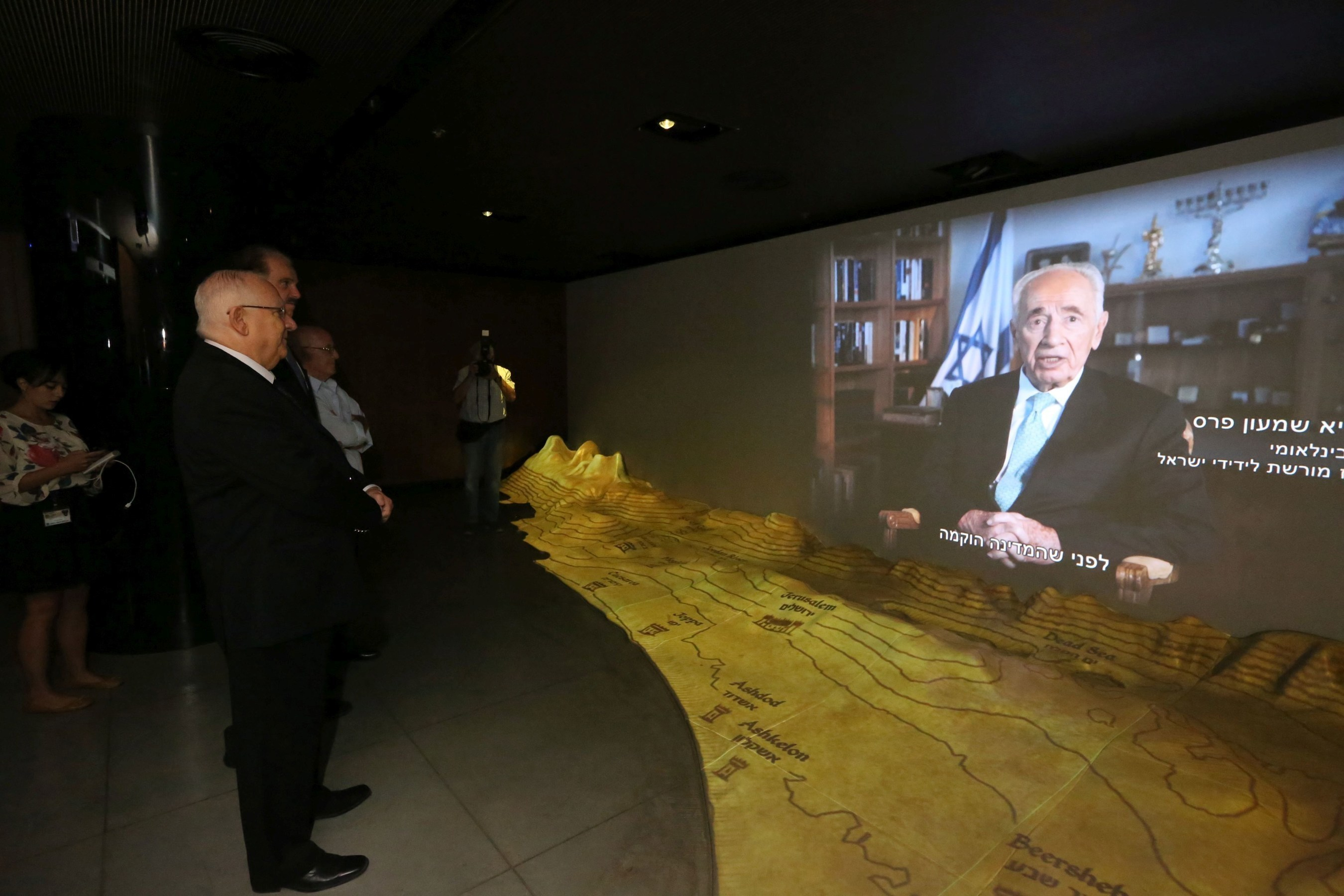 Israeli President Reuven Rivlin – joined by Dr. Evans, Museum Founder, and Gen. Peled, raised by Christians during the Holocaust – watching an introductory video by his predecessor, Shimon Peres, International Chairman of the Friends of Zion Museum. Photo Credit: Yossi Zamir