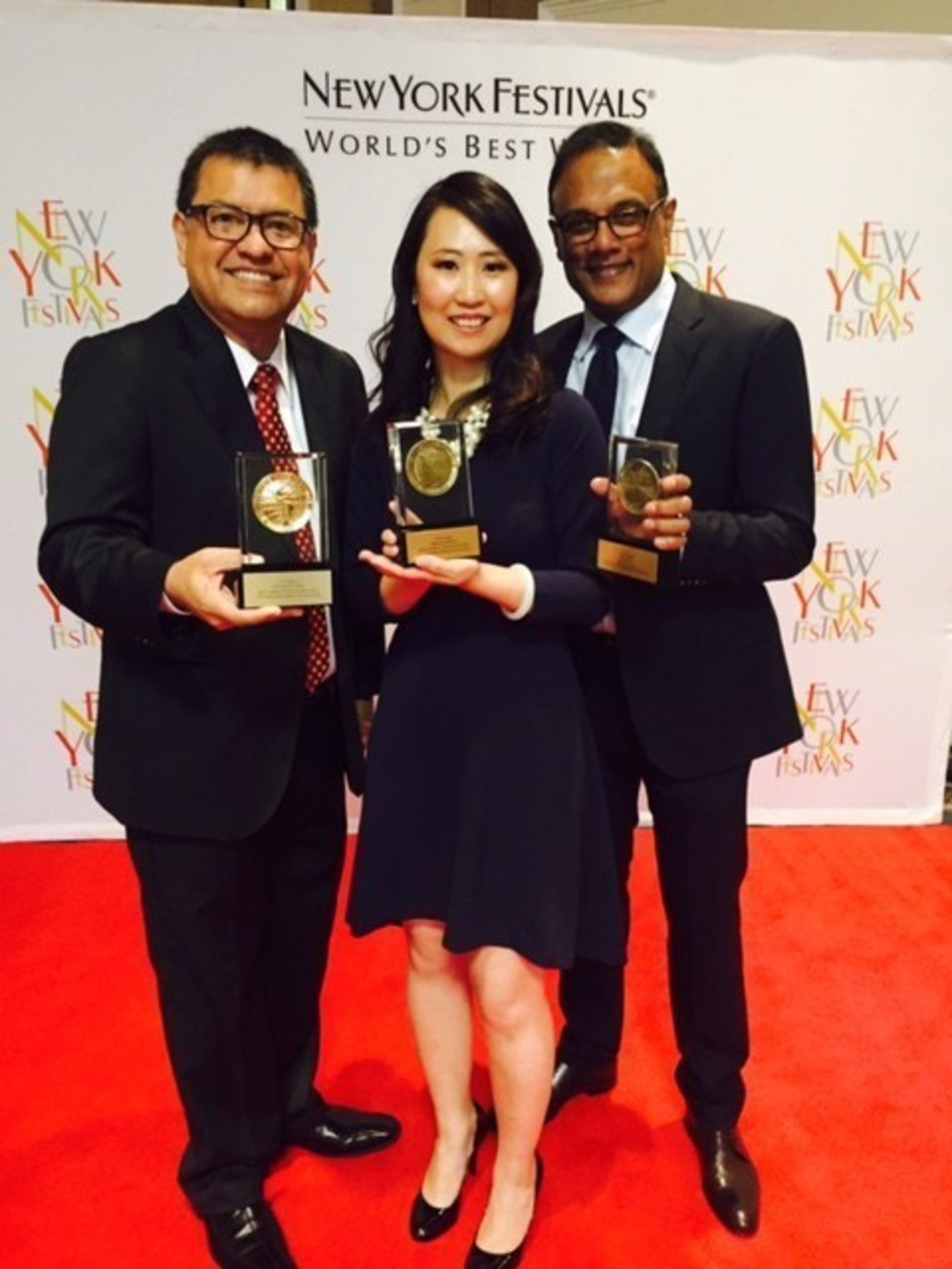 Americas Now Executive Producer Humberto Duran, Deputy Managing Editor Guo Chun and anchor Anand Naidoo with World Medals from the New York Festivals Awards for best in TV presented Tuesday night in Las Vegas