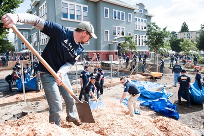 Volunteers from Delta and the community work together to build a playground in just one day for the children of the University Heights Center in Seattle. (PRNewsFoto/Delta Air Lines)