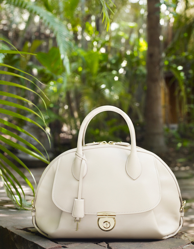 Medium ivory calf leather Fiamma bag - $2,250. Available at Salvatore Ferragamo boutique nationwide and ...