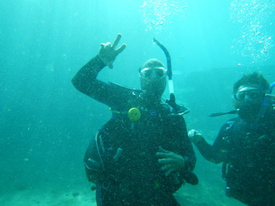 Wounded Warrior Project Alumni below the surface, signaling their diving success at a recent Alumni Program event.