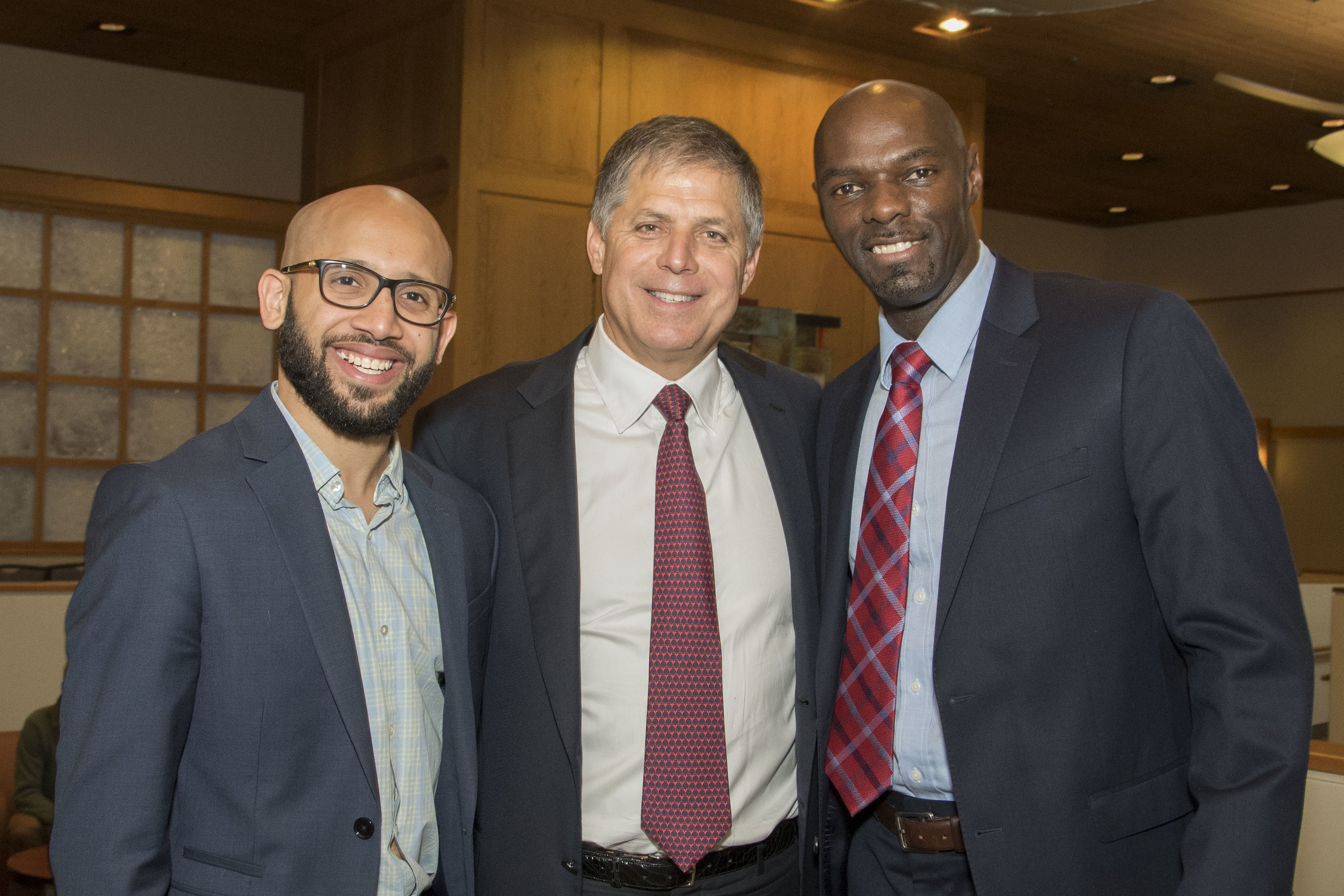 Guest speaker EJ Carrion stands with Rob Siegfried and Anthuan Maybank, co-founders of Siegfried Maybank Leadership Program(TM)