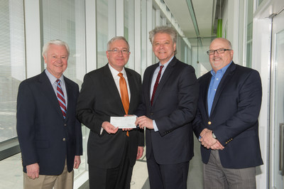 "GDF SUEZ Energy Resources demonstrates its commitment to the SyracuseCoE ""Partner Program.""  From left to right are Alan Lincoln and Edward A. Bogucz of SyracuseCoE and Victor Wulc and Tim Hughes of GDF SUEZ Energy Resources."