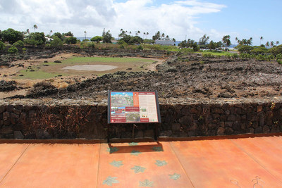 Interpretive sign overlooking Makahiki sporting arena and Poipu Beach park.