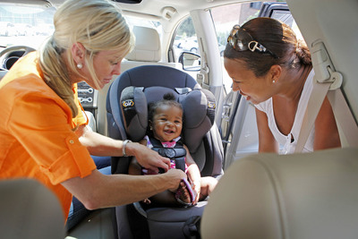 Child Safety Expert Kimberlee Mitchell, left, installs a car seat for Kennedy Word, 8 months, as mother Kimberly St. Louis looks on during a car seat check hosted by Dorel Juvenile Group and AAA in New York City this month. (PRNewsFoto/Dorel Juvenile Group, David Goldman)