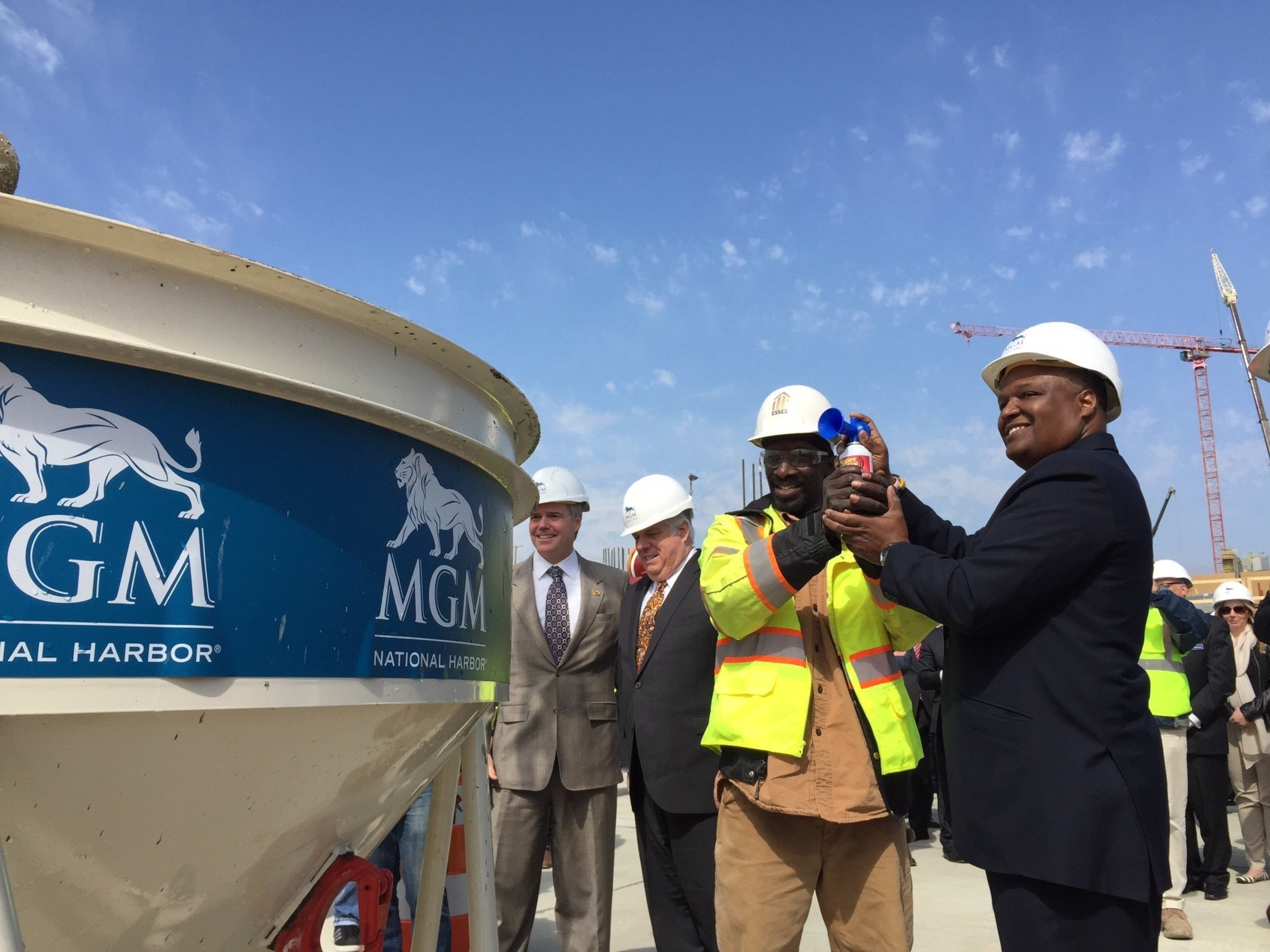 MGM National Harbor celebrates the hiring of the resort's 1000th construction employee with (Left to right) MGM Resorts International Chairman and CEO Jim Murren, Maryland Governor Larry Hogan, Essex Construction Labor Foreman Thomas Turner and Rushern Baker, County Executive of Prince George's County, MD.