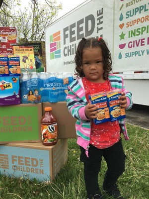 Child taking home StarKist® at a Feed the Children community event