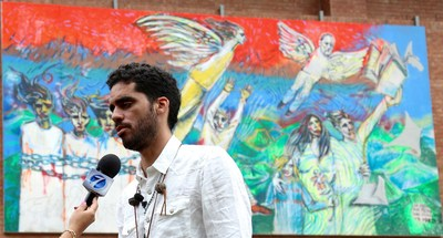 "Dissident Cuban graffiti artist El Sexto at the unveiling of his mural ""Freedom Through Knowledge"" at UFM in Guatemala."