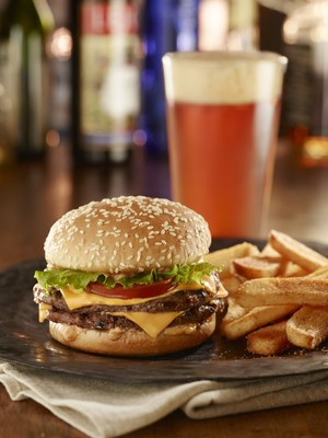 Whenever the Seahawks trigger a Tavern Double Tuesday promotion, Red Robin restaurants will serve up a FREE Red's Tavern Double burger with Bottomless Steak Fries with the purchase of two beverages and a burger, entree or entree salad. (PRNewsFoto/Red Robin Gourmet Burgers, Inc.)