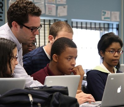 A tutor helps high school students with a computer coding assignment.  C Spire,, a Mississippi-based diversified telecommunications and technology services company, is partnering with the Base Camp Coding Academy, a charitable, non-profit vocational education program, to help train the state's next generation of software developers. - photo courtesy of Code HS
