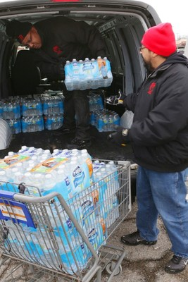 Matrix employees Andre Farmer and Joel Sauceda loading up for 1st delivery to provide relief to Flint residents