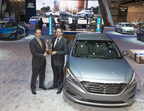 Left to Right: Steve Lind, executive vice president, operations, Cox Automotive Media, presents Brandon Ramirez, senior group manager, product planning, Hyundai Motor America, the trophy for Hyundai as the overall brand winner in the 2016 Kelley Blue Book 5-Year Cost to Own Awards at the 2016 Chicago Auto Show.