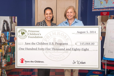 Pictured R to L, Primrose Schools President and CEO Jo Kirchner presents Lysa Ratliff, senior director of resource development for Save the Children, with a $145,000 donation to officially launch the national partnership. (PRNewsFoto/Primrose Schools)