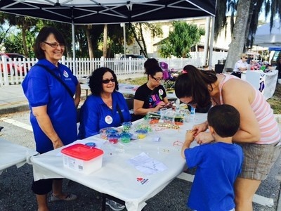 Staff members from volunteered at the Palm Harbor Chamber of Commerce 40th Annual Harbor Art and Seafood Festival.