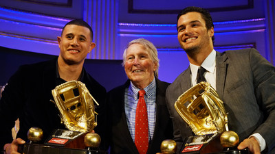 Rawlings Gold Glove Award winners for third basemen, Manny Machado of the Baltimore Orioles(TM) (left) and Nolan Arenado of the Colorado Rockies(TM) (right). Presenting is newly inducted Rawlings Gold Glove Hall of Fame awardee Whitey Ford at the Rawlings Gold Glove Awards in New York City on November 13, 2015.