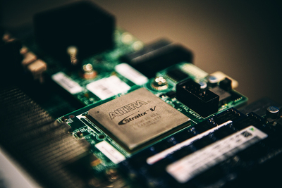 "Microsoft Research's Bing ""Catapult"" Fabric: An Altera Stratix FPGA sits on a board inside each server, accessible through PCIe, and wired directly to FPGAs in other servers to accelerate Bing workloads."