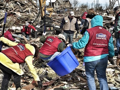 Lowe's Heroes search for a family's belongings amid piles of debris left by a tornado in Fairdale, Illinois.