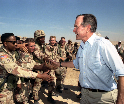 President George H.W. Bush talks with troops in Saudi Arabia, Nov. 22, 1990. (PRNewsFoto/GEORGE BUSH ...