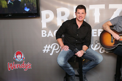 Multi-platinum Recording Artist and Television Personality Nick Lachey serenades Wendy's new Pretzel Bacon Cheeseburger with fans' love-filled tweets for its #PretzelLoveSongs campaign July 8, 2013 in New York City.  (Photo by Neilson Barnard/Getty Images for Wendy's).  (PRNewsFoto/The Wendy's Company, Neilson Barnard)