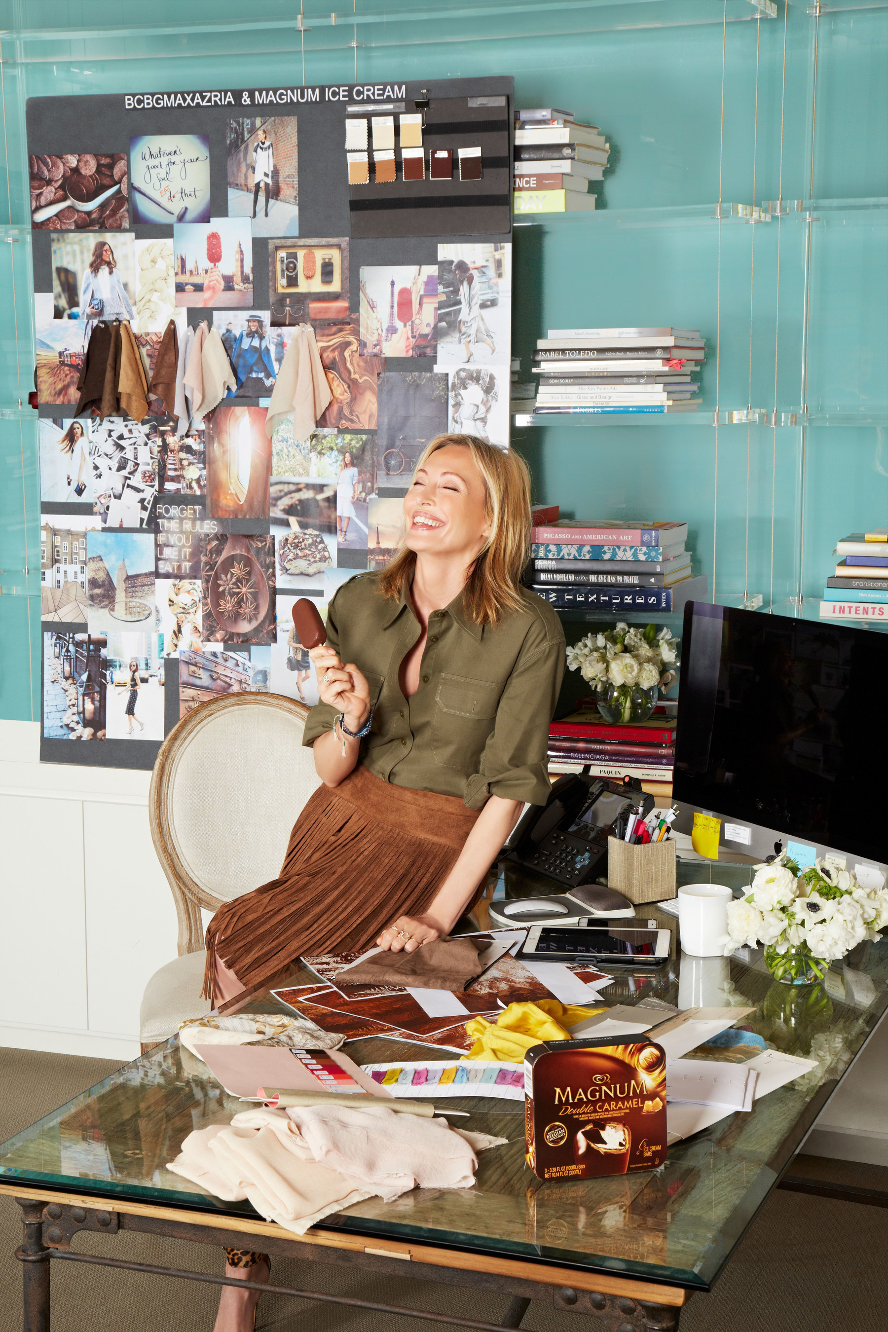 Lubov Azria, chief creative officer of BCBGMAXAZRIA, surrounded by the inspiration for the BCBGMAXAZRIA for MAGNUM Belgian Chocolate Wrap, an innovative accessory infused with an aroma inspired by MAGNUM Belgian Chocolate.