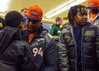 Broncos Defensive Tackle Terrance Knighton from Windsor, Conn. gives a student at Sacred Heart School in Jersey City a new coat during a Knights of Columbus Coats for Kids distribution on Jan. 28. (PRNewsFoto/Knights of Columbus) (PRNewsFoto/KNIGHTS OF COLUMBUS)