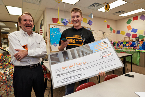 """Timken Company chairman of the board Ward J. """"Tim"""" Timken, Jr. visited North Canton (Ohio) Hoover High School today and presented senior Mitchell Fabian with a $50,000 college scholarship worth up to $200,000. The Timken Company Charitable and Educational Fund, Inc., funds the Henry Timken scholarship and 37 others awarded in eight countries around the world to the children of Timken associates. (PRNewsFoto/The Timken Company) (PRNewsFoto/The Timken Company)"""