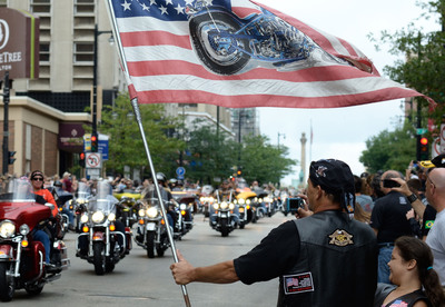 Tens of thousands of local fans line the streets of Milwaukee as nearly 7,000 Harley-Davidson riders paraded about five miles through the downtown streets.  (PRNewsFoto/Harley-Davidson Motor Company/Mike Fitch)