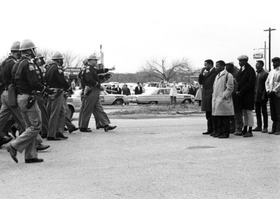 "Police and protesters face off over voting rights in Selma, Ala., May 7, 1965, a day forever known as Bloody Sunday. A new exhibit, ""1965: Civil Rights at 50"" opens Friday, Jan. 16, at the Newseum in Washington, D.C. Credit: Spider Martin"
