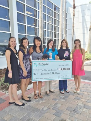 The Pet Paradise team presented The Mr. Mo Project with their $10,000 donation from the second annual Life is Short, Make a Splash campaign.