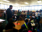 Former Jacksonville Jaguars offensive lineman and CEO of Healthy Schools, LLC, Tony Boselli, talks to children about the importance of annual flu vaccination as part of the Teach Flu a Lesson program. (PRNewsFoto/Families Fighting Flu)