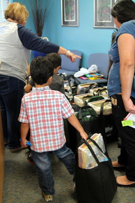 Students from Edgewood Elementary School in Spring Branch Texas, whose homes were destroyed by fire, receive school supplies donated by Terry Bryant Accident & Injury Law.