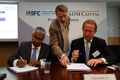 Serge Devieux IFC Director for Financial Markets Asia and Christopher Botsford, CEO of ADM Capital signed contract to launch the innovative lending facility to turn around Asian midsize companies.  (PRNewsFoto/ADM Capital; IFC)