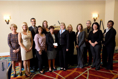 Aimco Regional Property Manager Jennifer Jarvis; Aimco Director of D.C. Operations Kim Zylka; Jorge Rosa, Director, Cushman & Wakefield's Mid-Atlantic Multifamily Advisory Group; Riverside Apartments Community Manager Tymeka Penn; Jill Soucy, Regional Account Executive, Apartment Finder; NLHA Executive Director Denise Muha; Aimco Communications Director Cindy Duffy; Angela Grassa, D.C. Market Sales Manager, and Jodi Killar Account Executive, Apartment Guide; Paul Davis, founder of Marcus & Millichap/IPA Affordable Housing Advisors, Aimco Director of Human Resources Mary Truitt, and Tyra Fleurimond, Kirkwood House Community Manager, participate in Aimco's check presentation of $160,000 to the NLHA Education Fund.  (PRNewsFoto/Aimco)
