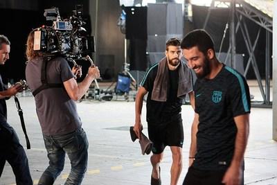 FC Barcelona's Arda Turan and Gerard Pique Star In The Latest Lassa Tyres Commercial (PRNewsFoto/Lassa Tyres)