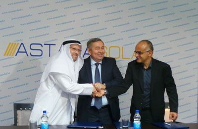 Salim Abbassi, CEO of Qatar Solar Energy, Kamel Ounadjela, Board Member of Qatar Solar Energy and Azat Betekbaev, Chairman of Astana Solar,  Kazatomprom's solar division, conclude the signing ceremony in Astana, Kazakhstan