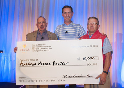 Vista Outdoor's Dave Allen (center) presented the $10,000 check to Colonel Randy Watt and Matt Barber from Hand in Hand Outdoors