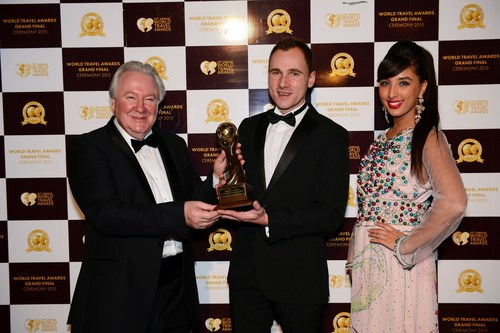 Michal Kowalczuk accepting the award for World's Leading Car Rental Company App at the 2015 World Travel ...
