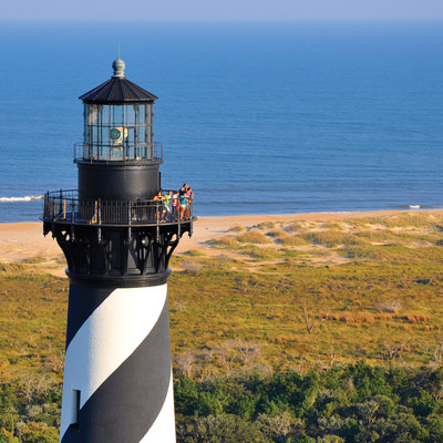 Visitors to the OBX can climb three lighthouses this summer, including the tallest one in America, the Cape Hatteras Lighthouse. It watches over the Atlantic Ocean from the heart of the Cape Hatteras National Seashore; together with Wright Brothers National Memorial and Fort Raleigh National Historic Site, there are three national parks you can explore during your Outer Banks vacation as part of the National Parks Centennial.