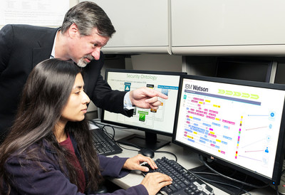 """IBM's Chief Watson Security Architect Jeb Linton demonstrating to University of Maryland Baltimore County student Lisa Mathews how to teach IBM's Watson the language of security, Tuesday, May 10, 2016, Baltimore, MD. IBM will work with 8 universities to train Watson for Cyber Security, so that the next generation of security professionals can leverage the power of """"cognitive"""" technology to defend against cyberattacks.  (Mitro Hood/Feature Photo Service for IBM)"""