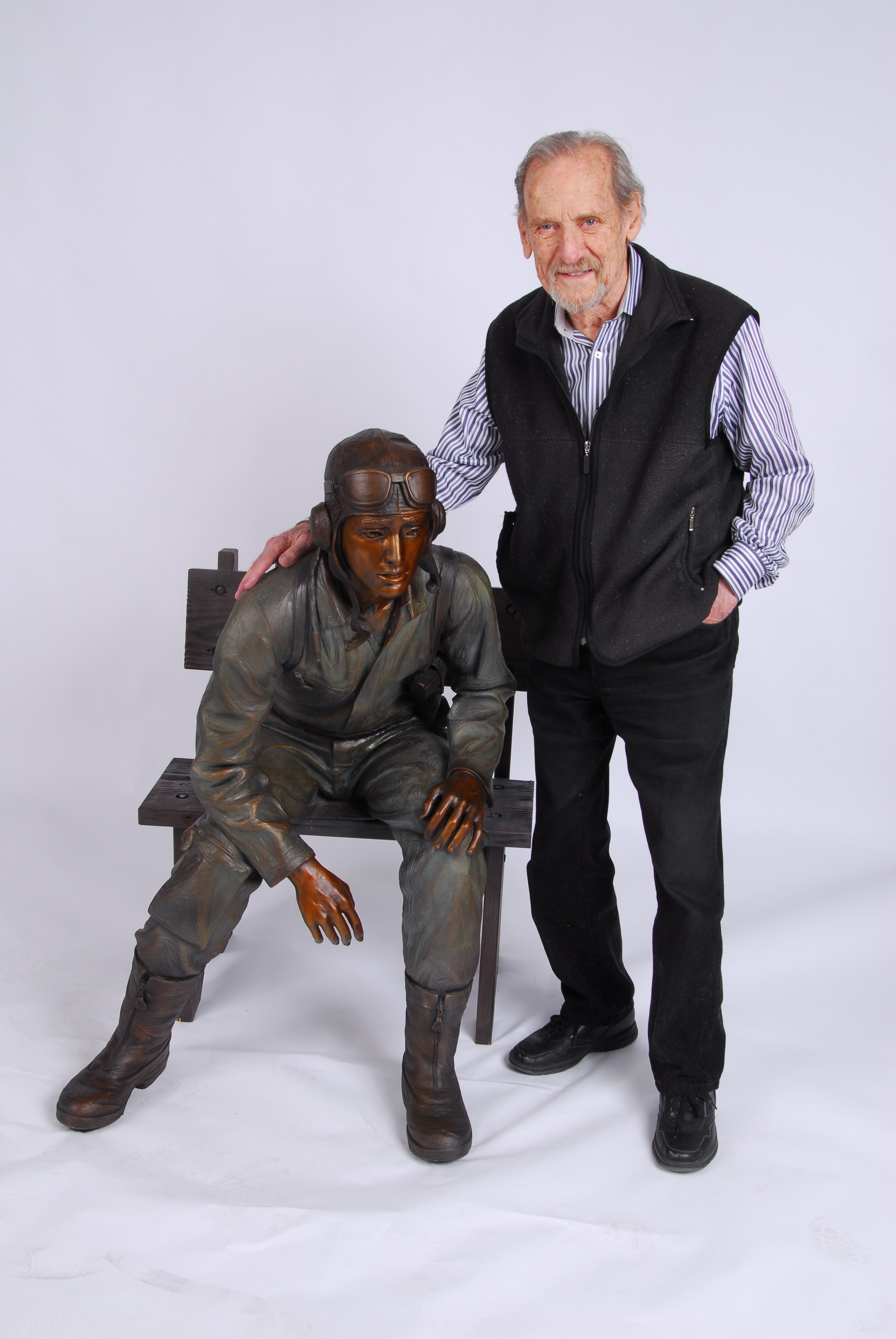 Major Fredric Arnold, USAAC (ret.) stands with TEENAGER, one of twelve life-size bronze statues he created to honor the 88,000 American Airmen who died in WWII.