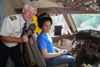 Wish kid Chidinma, with United Captain Curt Hinkle, gets ready for takeoff to Rome on United's 10,000th donated ticket to Make-A-Wish.