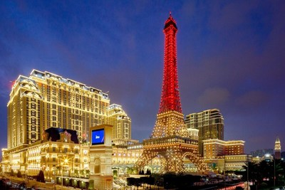 The Parisian Macao and its red-lit Eiffel Tower illuminate the night sky on Macao's Cotai Strip Tuesday – the opening day of Sands China's newest integrated resort.
