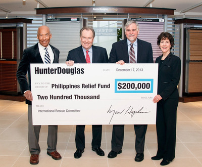 Hunter Douglas announced that it has donated a total of $200,000 to the International Rescue Committee (IRC), a global humanitarian organization, to help all those in need following Typhoon Haiyan, which devastated the central Philippines last month.  Marv Hopkins, Hunter Douglas President and CEO, presented the check to John Keys, Senior Vice President of Programs for the IRC. From left to right, Gordon Khan, Hunter Douglas SVP and CFO; Marv Hopkins, Hunter Douglas President and CEO; John Keys, IRC's SVP of Programs; and Mindy Fabrikant, Hunter Douglas VP of Corporate Human Resources.  (PRNewsFoto/Hunter Douglas Inc.)