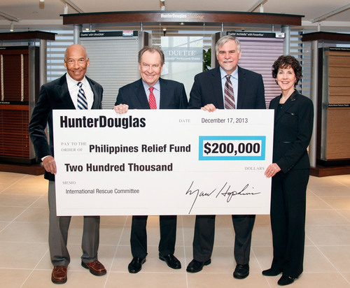 Hunter Douglas announced that it has donated a total of $200,000 to the International Rescue Committee (IRC), a global humanitarian organization, to help all those in need following Typhoon Haiyan, which devastated the central Philippines last month. Marv Hopkins, Hunter Douglas President and CEO, presented the check to John Keys, Senior Vice President of Programs for the IRC. From left to right, Gordon Khan, Hunter Douglas SVP and CFO; Marv Hopkins, Hunter Douglas President and CEO; John Keys, IRC's SVP of Programs; and Mindy Fabrikant, Hunter Douglas VP of Corporate Human Resources. (PRNewsFoto/Hunter Douglas Inc.) (PRNewsFoto/HUNTER DOUGLAS INC.)