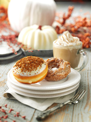 Krispy Kreme is combining the best of two seasonal flavors, cheesecake and pumpkin, for the ultimate fall treats. Savor the season with Krispy Kreme Pumpkin Spice and new Pumpkin Cheesecake doughnuts.  Available now through November 27 at participating Krispy Kreme US and Canadian locations.  (PRNewsFoto/Krispy Kreme Doughnut Corporation)